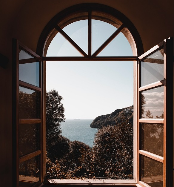 sips garden room window looking out over a sea view