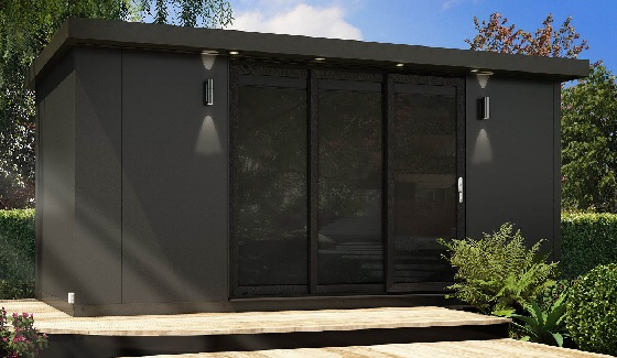 Garden room in a dark colour with tinted glass in a garden setting